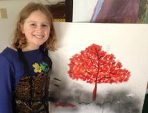 A proud artist stands by her work created at the Annex.