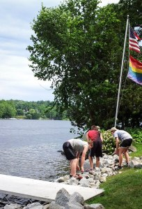 YCC crew members installing rip rap to stabilize a shoreline.