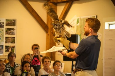 "Matt Weeks, a presenter with Chewonki delighted visitors with a program on ""Owls of Maine""."