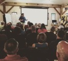 Dr. Whitney King addressed a room crowded with community members at our Water Quality Community Meeting this August.